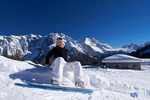 Female Snowboarder in Mountains