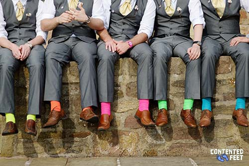 Men wearing colored socks