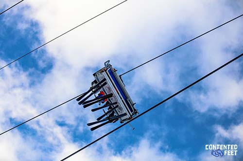 Skiers On The Chairlift